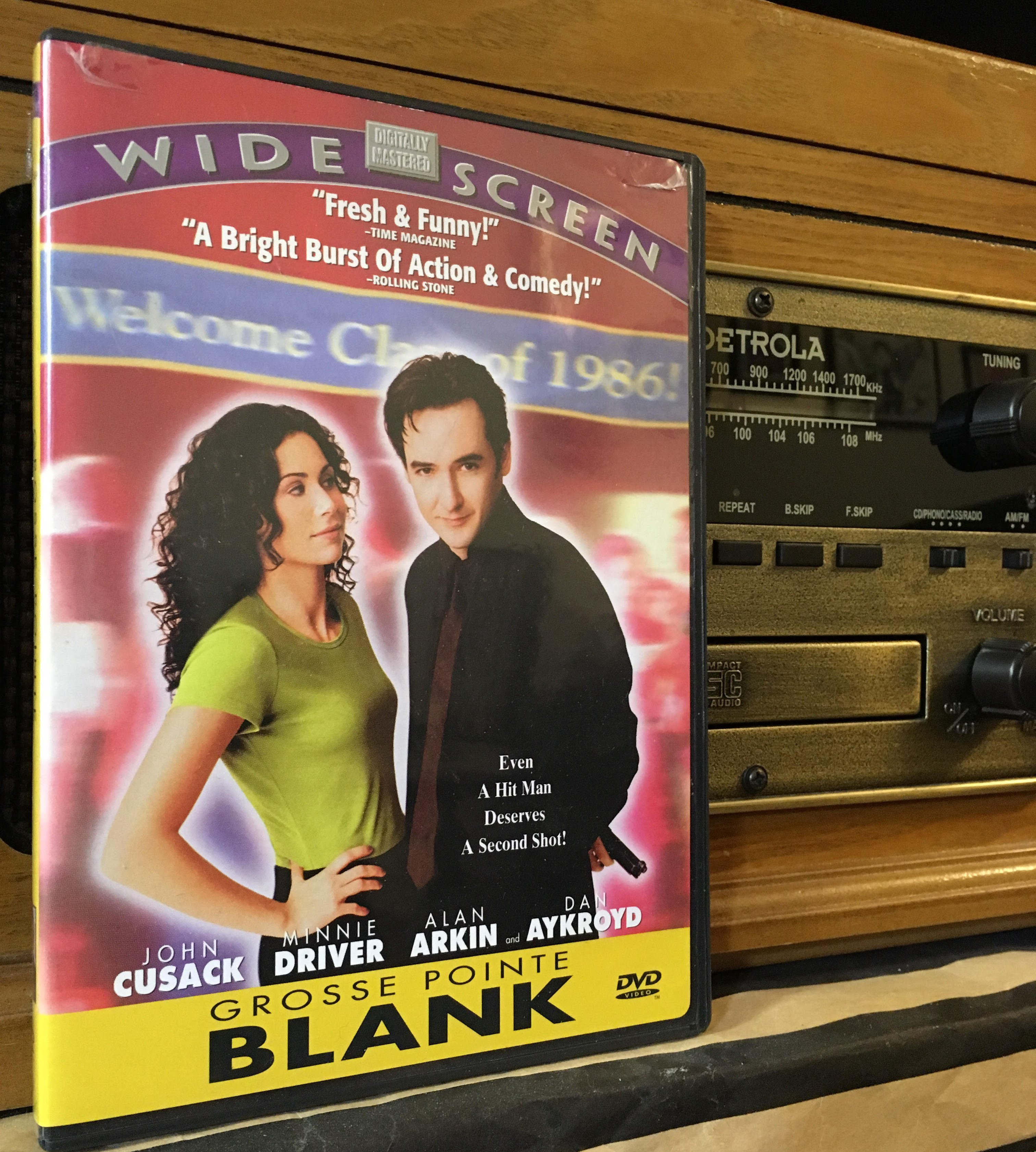 """DVD of """"Grosse Pointe Blank"""" in front of a radio"""