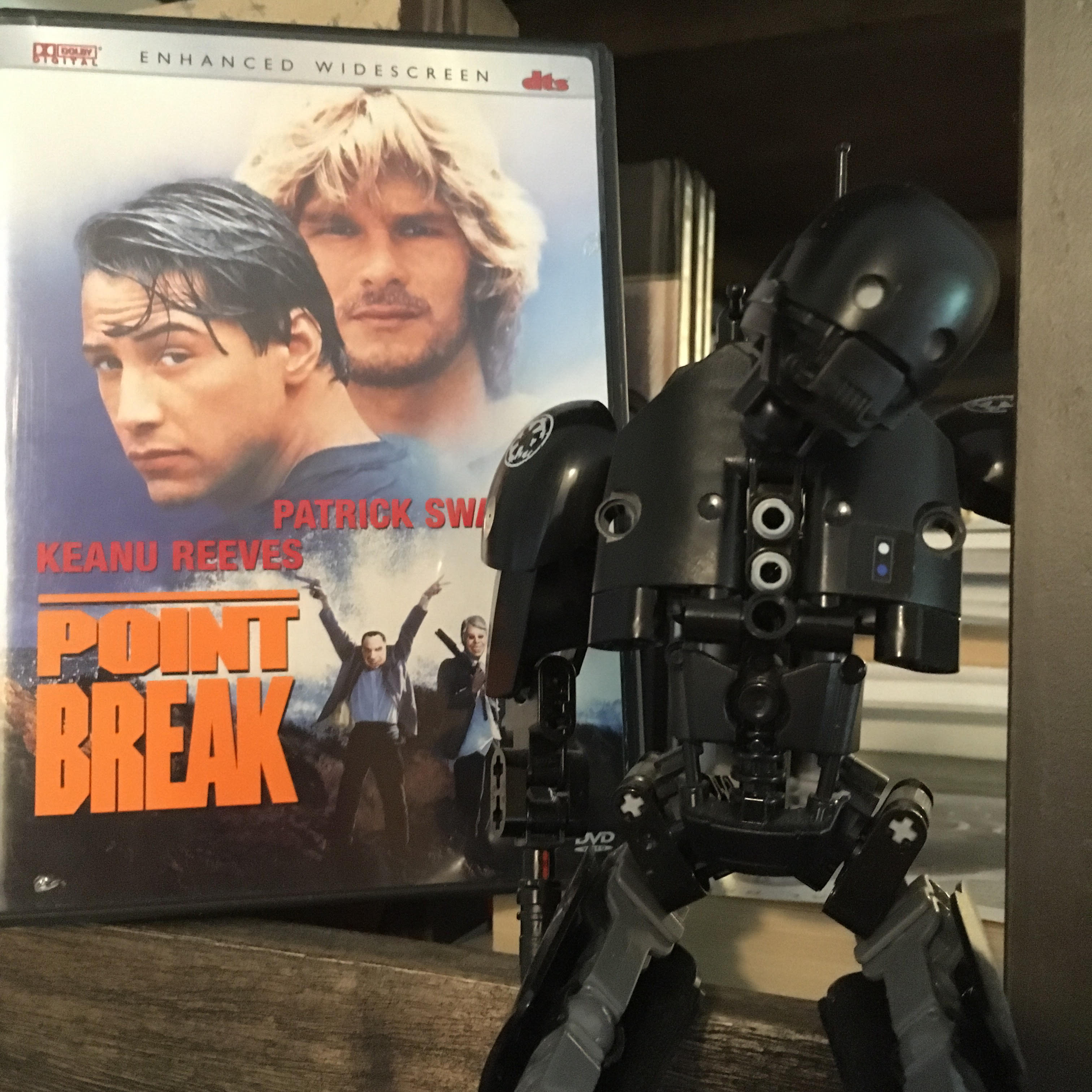 """DVD of """"Point Break"""" with a figure of K-2SO"""
