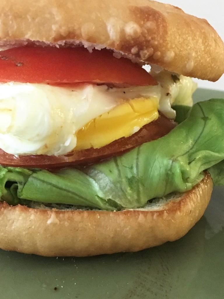 A bagel breakfast sandwidch