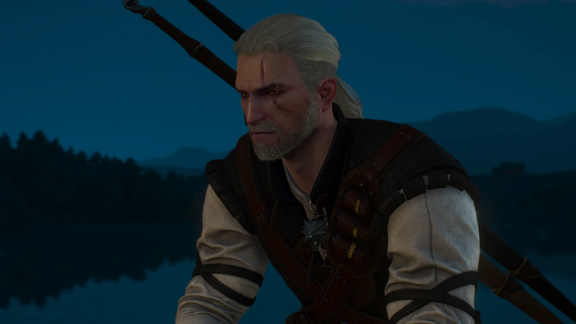 A close up of Geralt, a man with long white hair pulled back, as he sits by a lake in the woods. From The Witcher 3 video game.