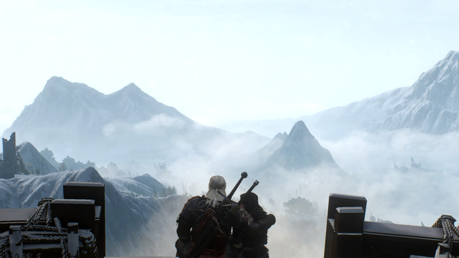 Geralt, a man with long white hair, with his arm around Yennefer, a woman with long dark hair, as they look over a misty mountain landscape